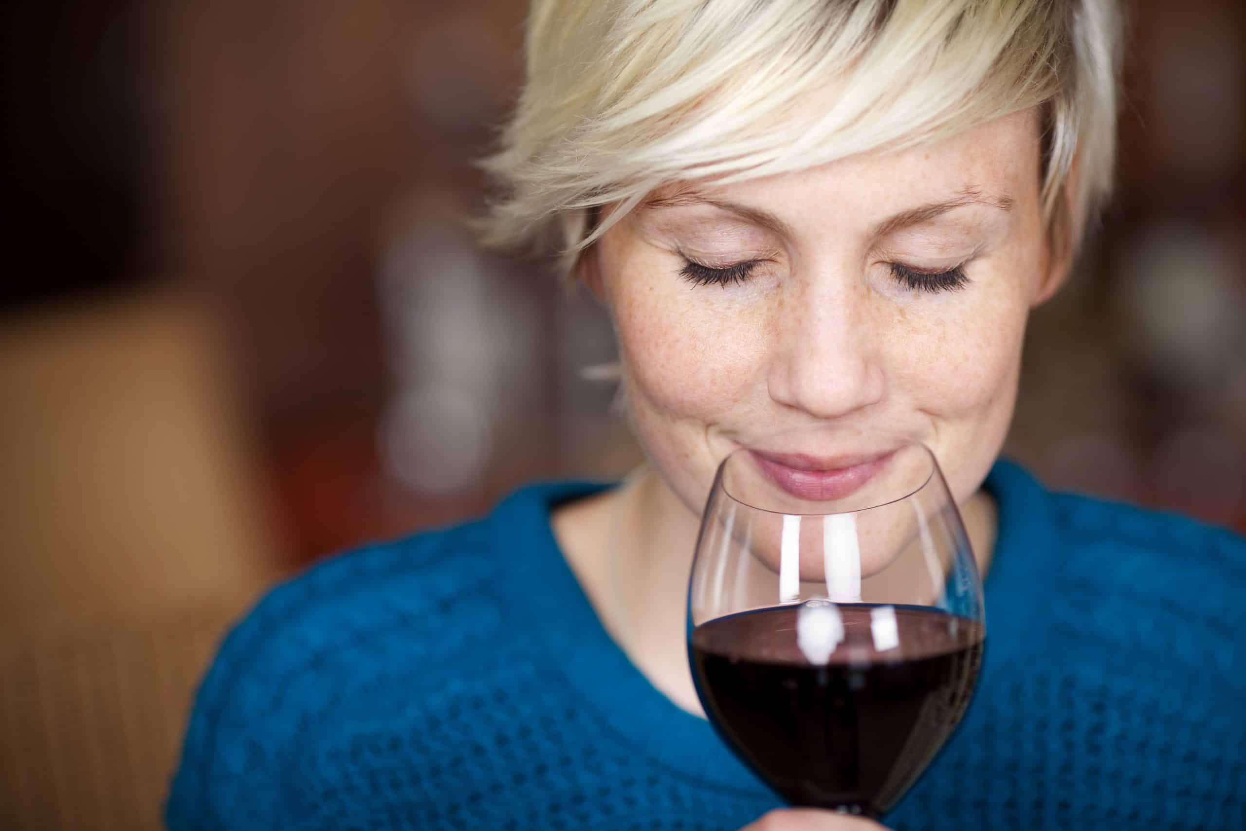 Closeup,Portrait,Of,Young,Female,Customer,Drinking,Red,Wine,With